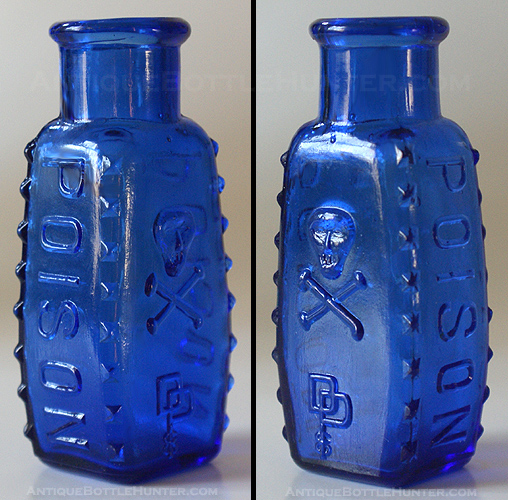 A cobalt coffin shaped KU-8 with skull and crossbones plus DP CO. --- Antiquebottlehunter.com