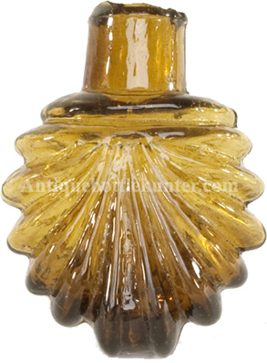 Scallop shell amber smelling bottle or scent. Height, 2 - 3/8 in. Width, 1 - 7/8 in. --- AntiqueBottleHunter.com