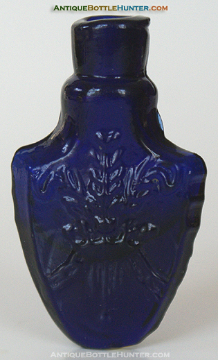 A deep purplish cobalt blue mold blown shield shaped smelling bottle --- AntiqueBottleHunter.com