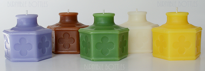 A group of CARTER'S (with four leaf clovers) ink bottle candles --- Burnable Bottles - AntiqueBottleHunter.com