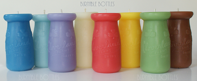 A group of CLOVERLAND FARMS DAIRY 1/4 pint milk bottle candles --- Burnable Bottles - AntiqueBottleHunter.com