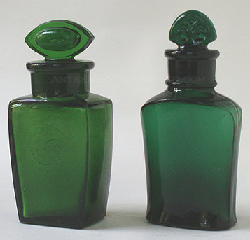 Two Colgate salts bottles - First, a yellow green embossed lightly in a circle is 'C & Co.' Right, is a dark emerald green that is base embossed: COLGATE & CO. over 27 over NEW YORK. Heights w/out stoppers, 2 - 3/4 in. and 3 in. --- AntiqueBottleHunter.com