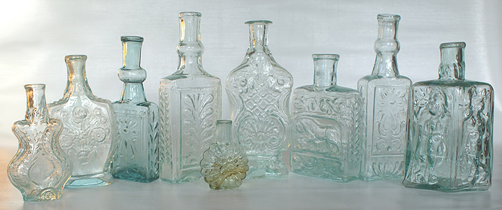 A group picture of early colognes. --- AntiqueBottleHunter.com