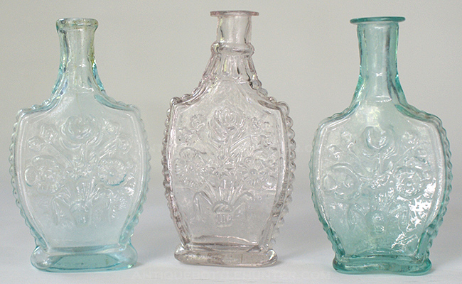 Three very similar colognes referred to as the 'Floral Spray'. (4 - 3/8 in., 4 - 3/8 in. and 4 - 1/4 in.) --- AntiqueBottleHunter.com