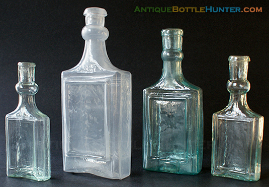 Four framed label only colognes with bulbous necks... or are they? --- AntiqueBottleHunter.com