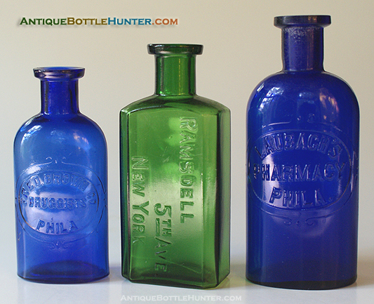 A blue FRED BROWN CO. / DRUGGISTS / PHILA. DRUG CO., a yellow green RAMSDELL / 5TH AVE. / NEW YORK and a blue LAUBACH'S / PHARMACY / PHILA. --- Antiquebottlehunter.com