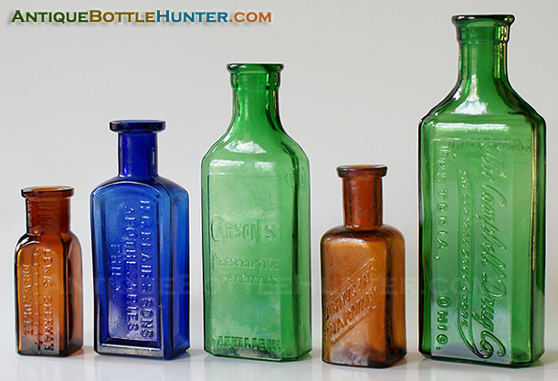 An amber LEWIS SHERMAN, a blue H.C. BLAIR'S SONS, a yellow green CARSON'S, an amber JOHNSON'S PHARMACY and a yellow green CAMPBELL DRUG CO. --- Antiquebottlehunter.com