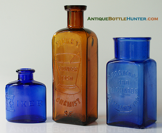 A blue RIKER, a bubbly amber DICKEY CHEMIST S.F. and a square blue GROSVENOR AND RICHARDS / BOSTON & NEW YORK. (2 1/2 in., 5 1/2 in., and 4 in.) --- Antiquebottlehunter.com