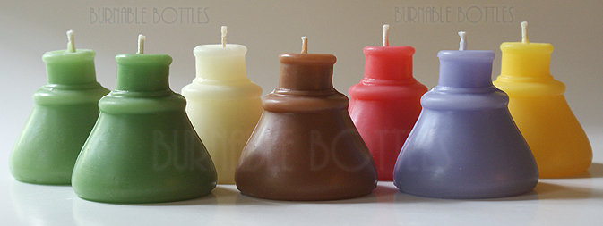 A group of cone ink bottle candles --- Burnable Bottles - AntiqueBottleHunter.com