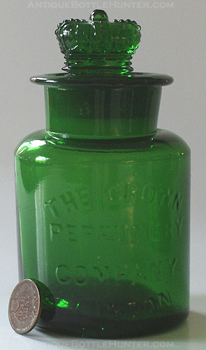 A much larger than normal CROWN PERFUMERY COMPANY bottle. --- AntiqueBottleHunter.com
