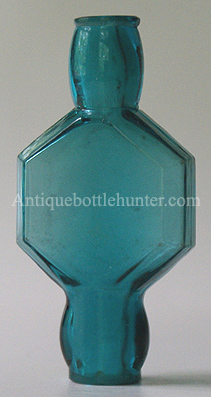 A teal blue/green smelling bottle with a hexagon shaped center and openings at both ends. Each lip has been ground and smoothed. Length, 2 - 7/8 in. Width, 1 - 3/8 in. --- AntiqueBottleHunter.com