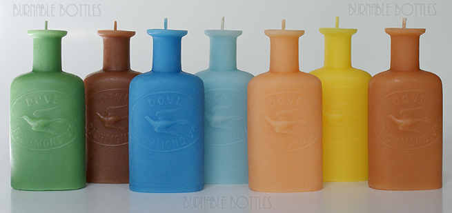 A group of DOVE (embossed dove) RICHMOND, VA. bottle candles --- Burnable Bottles - AntiqueBottleHunter.com