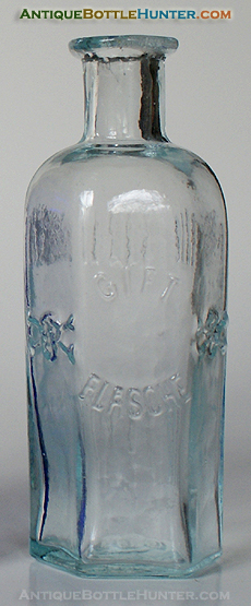 A light aqua GIFT / FLASCHE skull and crossbone poison. --- Antiquebottlehunter.com
