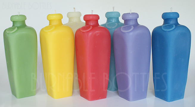 A group of small case gin bottle candles--- Burnable Bottles - AntiqueBottleHunter.com