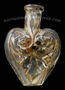 A heart shaped smelling bottle with gold paint - McK. plate 104 #8. Height, 2 - 3/16 in. --- AntiqueBottleHunter.com
