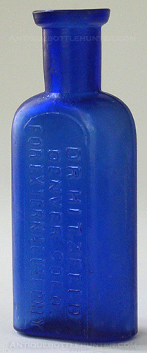 A blue druggist or medicine that is also considered a poison bottle. It is embossed in three lines: DR. HITZFELD / DENVER, COLO. / FOR EXTERNAL USE ONLY (3 - 1/2 in.) --- Antiquebottlehunter.com