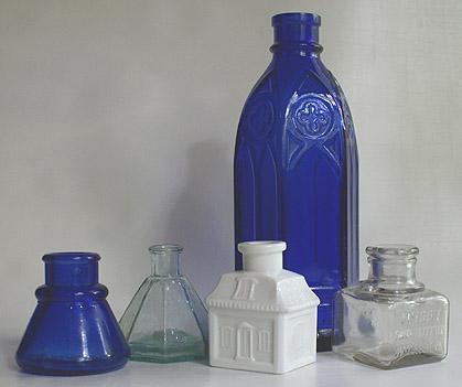 Vintage inkwells and bottles