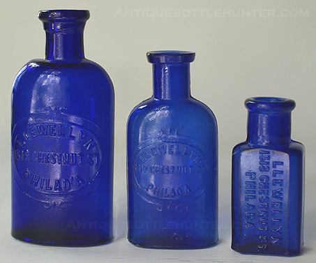 Three blue LLEWELLYN / CHESTNUT ST. / PHILAD'A. The middle one is from 1410, but the others are from 1518 Chestnut St. --- Antiquebottlehunter.com