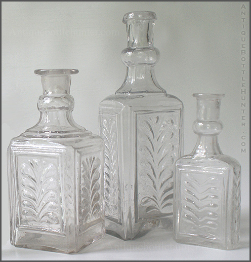 A group of three early colorless colognes with plumes. --- AntiqueBottleHunter.com