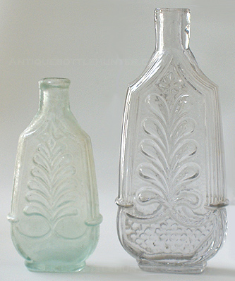 An aquamarine and taller colorless 'Plume and Column' cologne. (4 in. and 5 - 1/2 in.) --- AntiqueBottleHunter.com