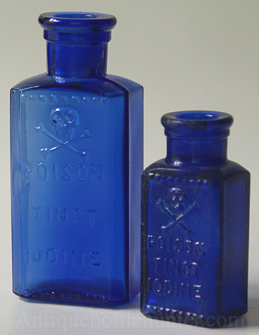 Both sizes of the blue KR-3s with nice skull and crossbones. --- AntiqueBottleHunter.com