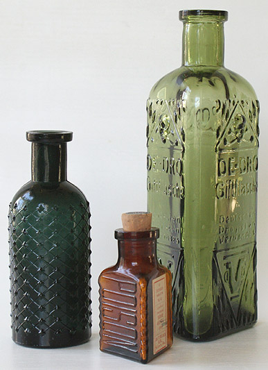 A dark teal KC-1 (4 - 1/2 in.), then an amber KT-5 with label and cork (2 - 1/2 in.) and finally a mossy yellow green KT- 22 (7 in.) --- AntiqueBottleHunter.com