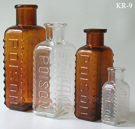 An amber (5 - 3/8 in.), clear (4 - 5/8 in.), amber (4 - 3/8 in.) and clear (2 - 5/8 in.) set of KR-9s --- AntiqueBottleHunter.com