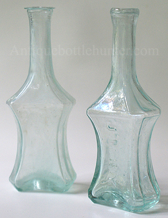 A couple of early aquamarine polygonal (8 sides) colognes. --- AntiqueBottleHunter.com