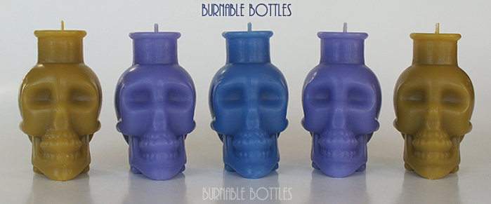 A group of skull bottle candles --- Burnable Bottles - AntiqueBottleHunter.com